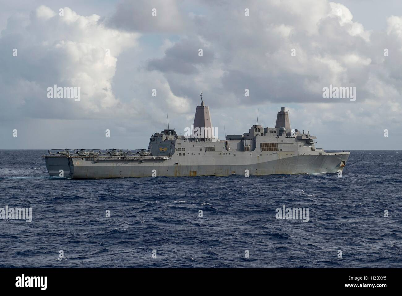 The USN San Antonio-class amphibious transport dock ship USS Green Bay steams in formation to signify the completion - Stock Image