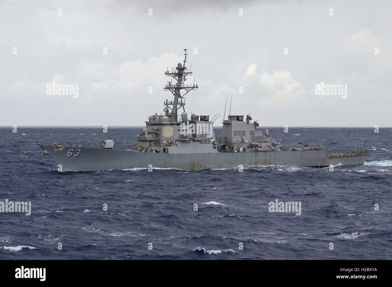 The USN Arleigh Burke-class guided-missile destroyer USS Stethem steams in formation to signify the completion of Stock Photo