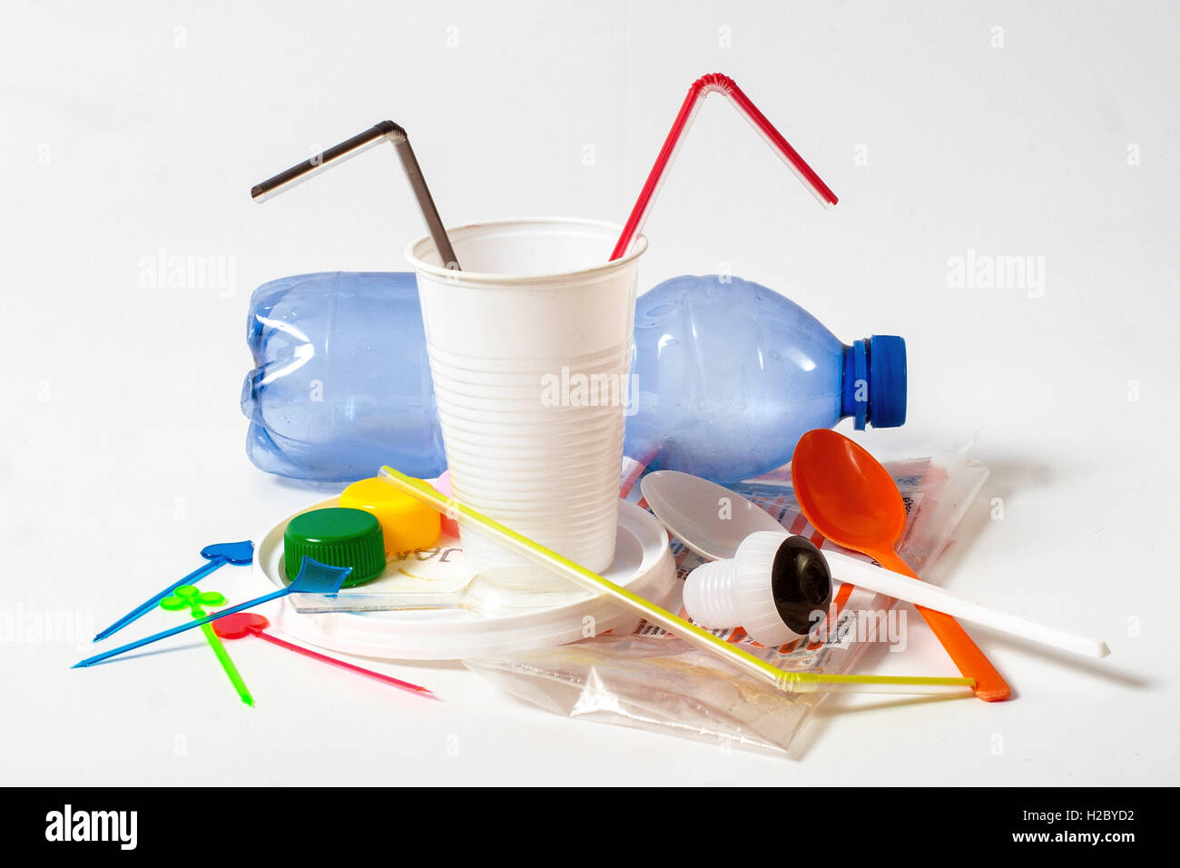 Assorted household plastic waste on white background - Stock Image