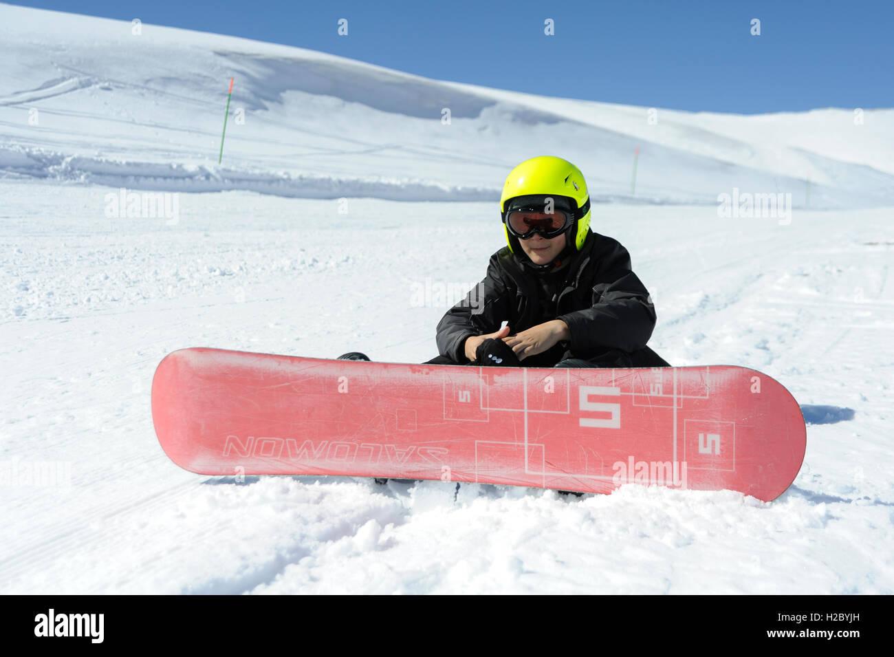 Teen with his snowboard, Faraya (Mzaar Kfardebian) ski resort, Lebanon - Stock Image