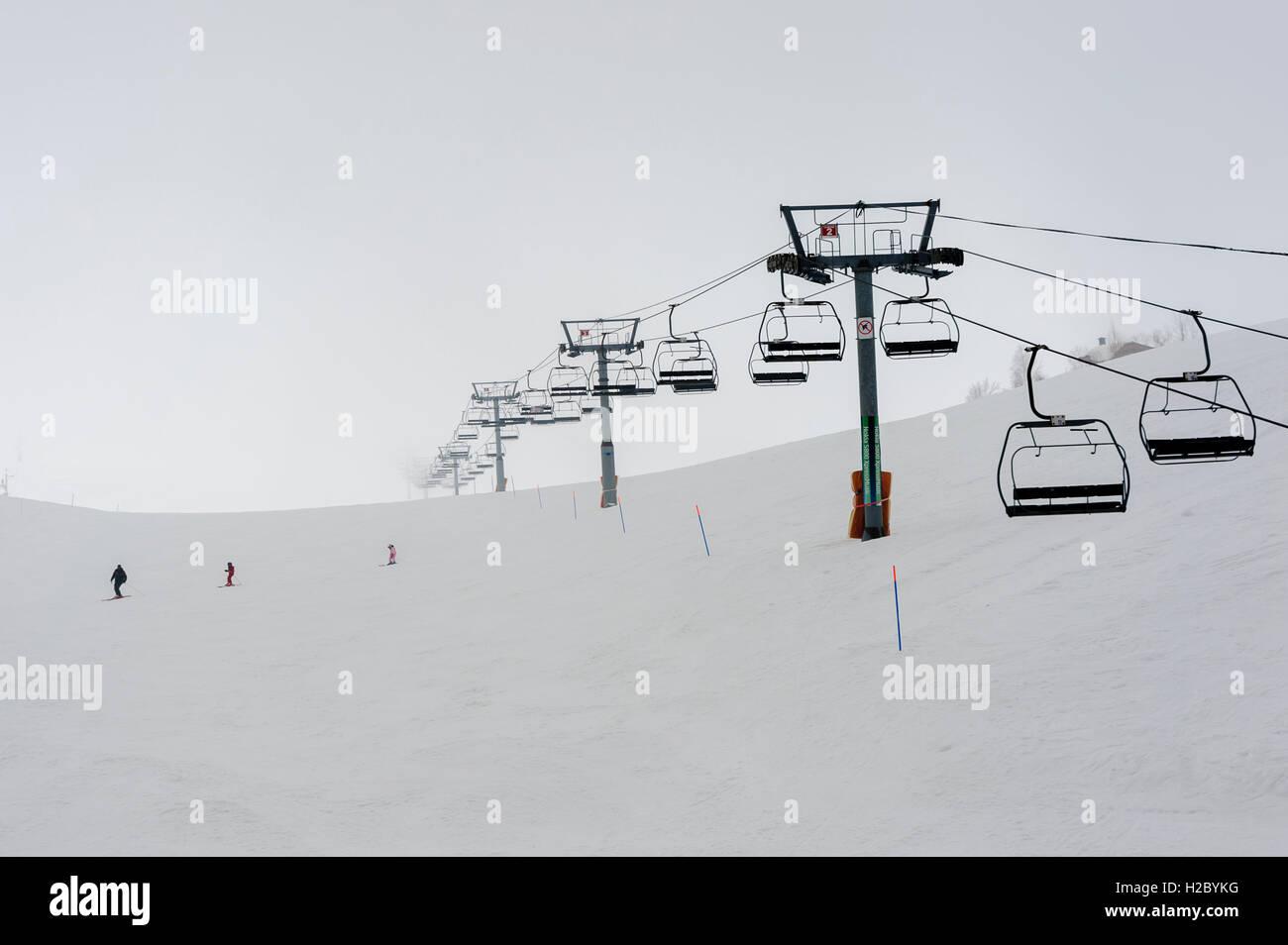 Chairlifts at Faraya (Mzaar Kfardebian) Ski resort during a snowy day, Lebanon - Stock Image