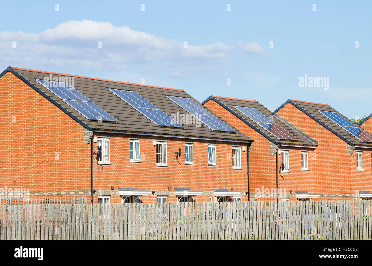 Solar panels on roofs of houses in England. UK - Stock Image