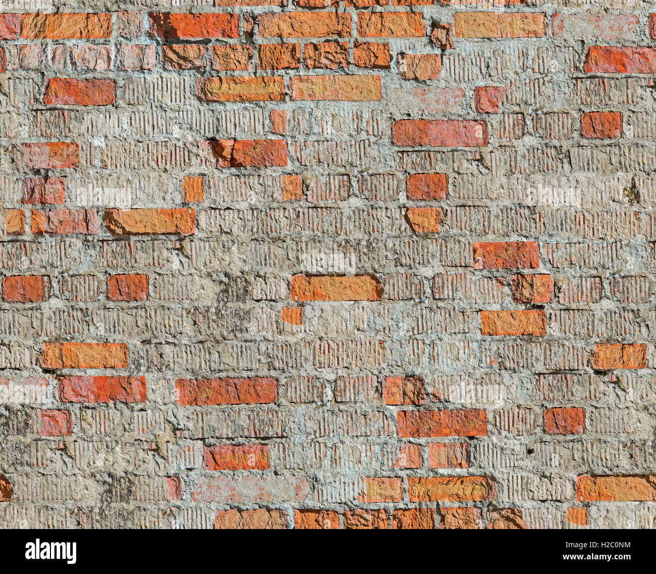 Brick wall of the old house of the 19th century restored after the bombing of the Second World War. Seamless texture - Stock Image