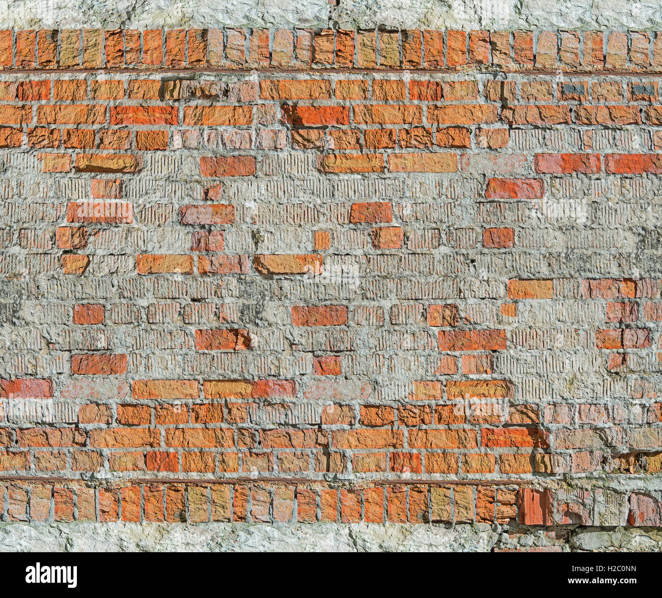Brick wall of the old house of the 19th century restored after the bombing of the Second World War - Stock Image