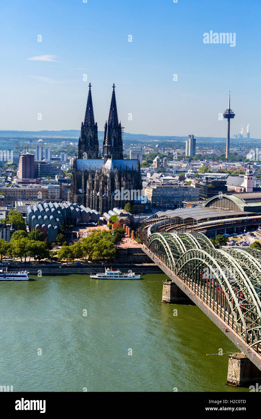 River Rhine and Cologne Cathedral (Kölner Dom) with Hohenzollern Bridge (Hohenzollernbrücke) in foreground, - Stock Image
