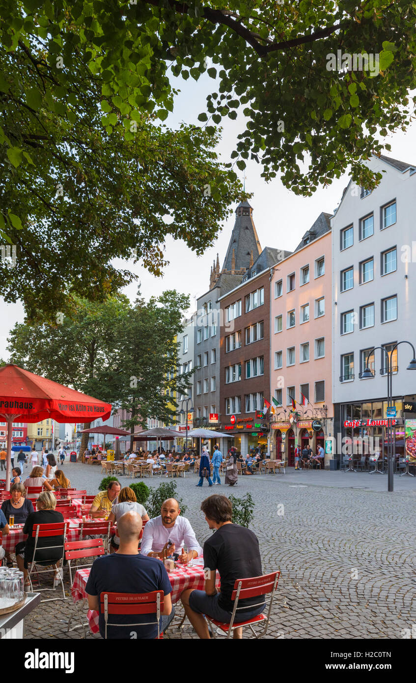 Cafes and shops in the Alter Markt  (Old Market Square) in the late afternoon, Altstadt, Cologne, Germany - Stock Image