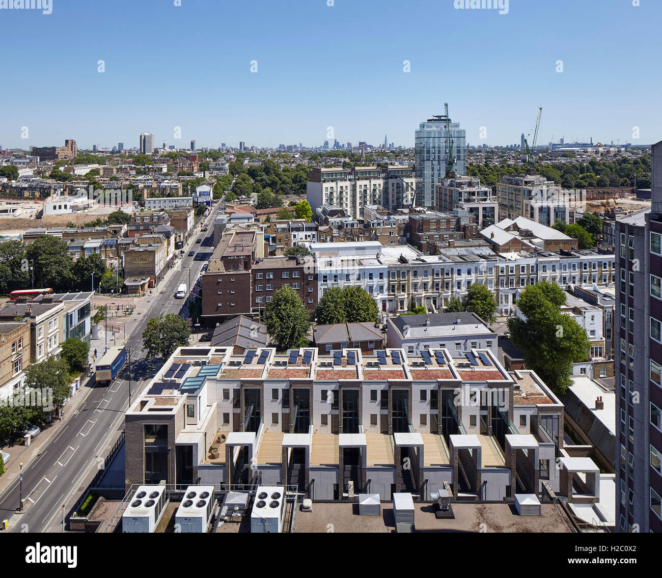 Arial view of Peel Place looking east with London on the horizon. Peel Place, London, United Kingdom. Architect: - Stock Image