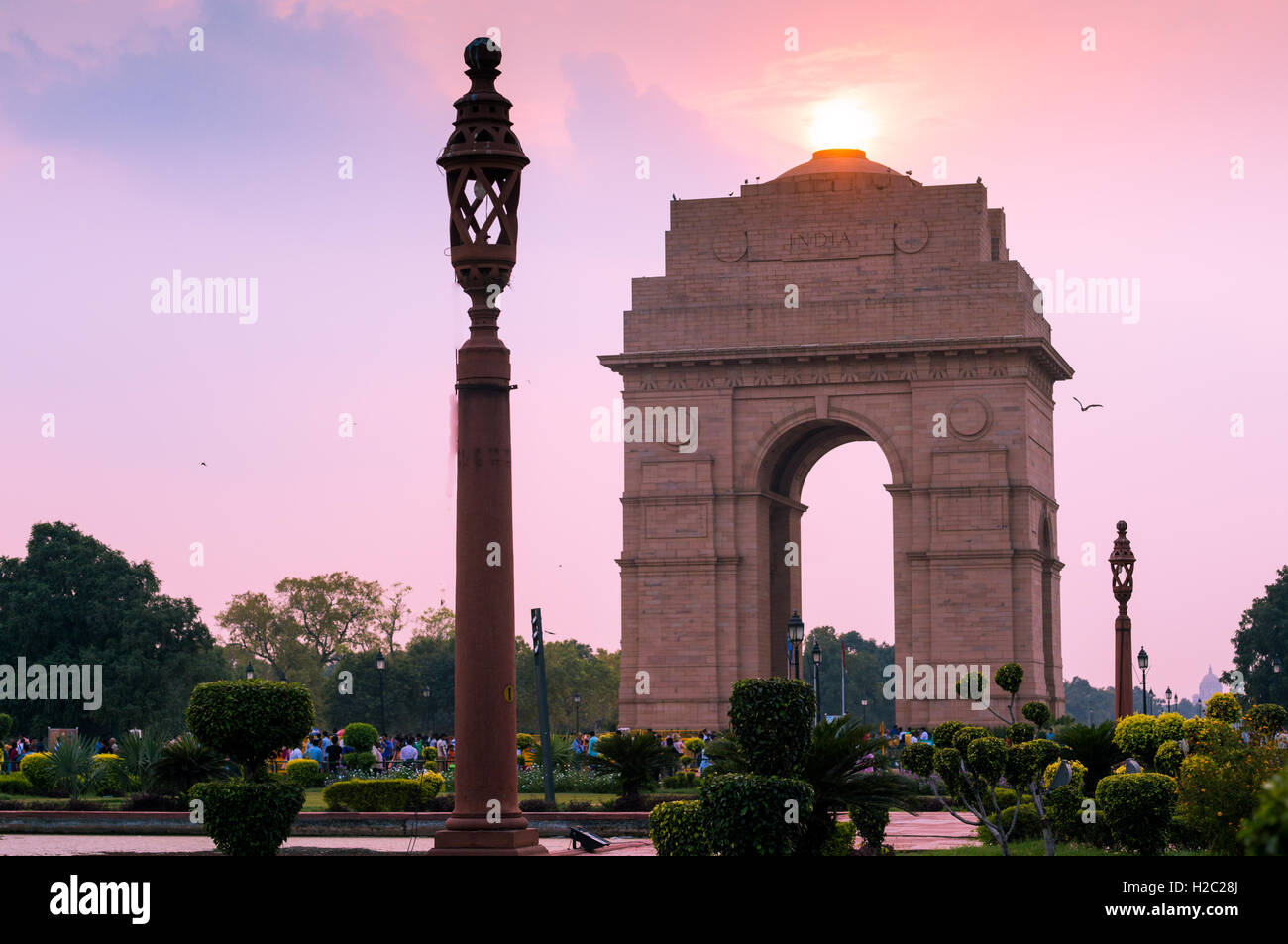 India gate in Delhi shot at dusk with the sun overhead and with a beautiful sky - Stock Image