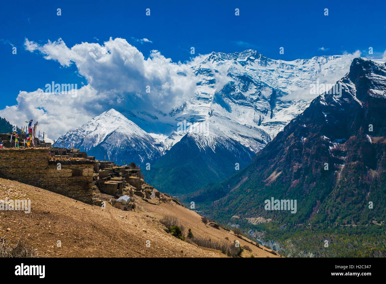 Landskape Photo Tracking Himallaya Vilage Side Hill.View Snow Nepal Mountans Background. Hikking Sport Travel. Horizontal Stock Photo