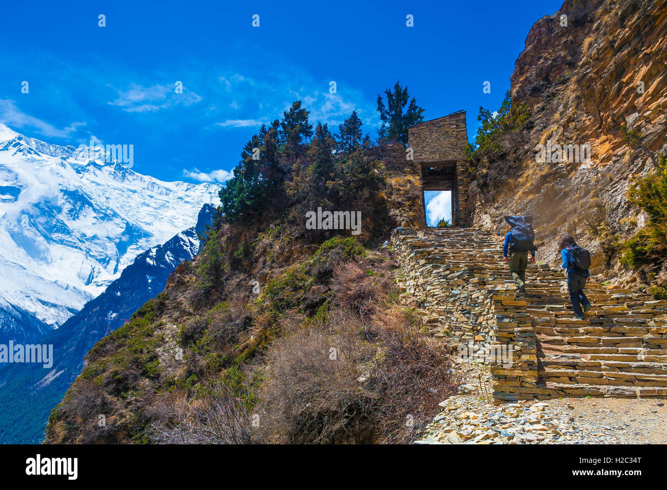 Two Person Backpack Trail Mountains Way.Mountain Trekking Rocks Path Landscape View Background.Hikking Travel Activity.HorizontaStock Photo