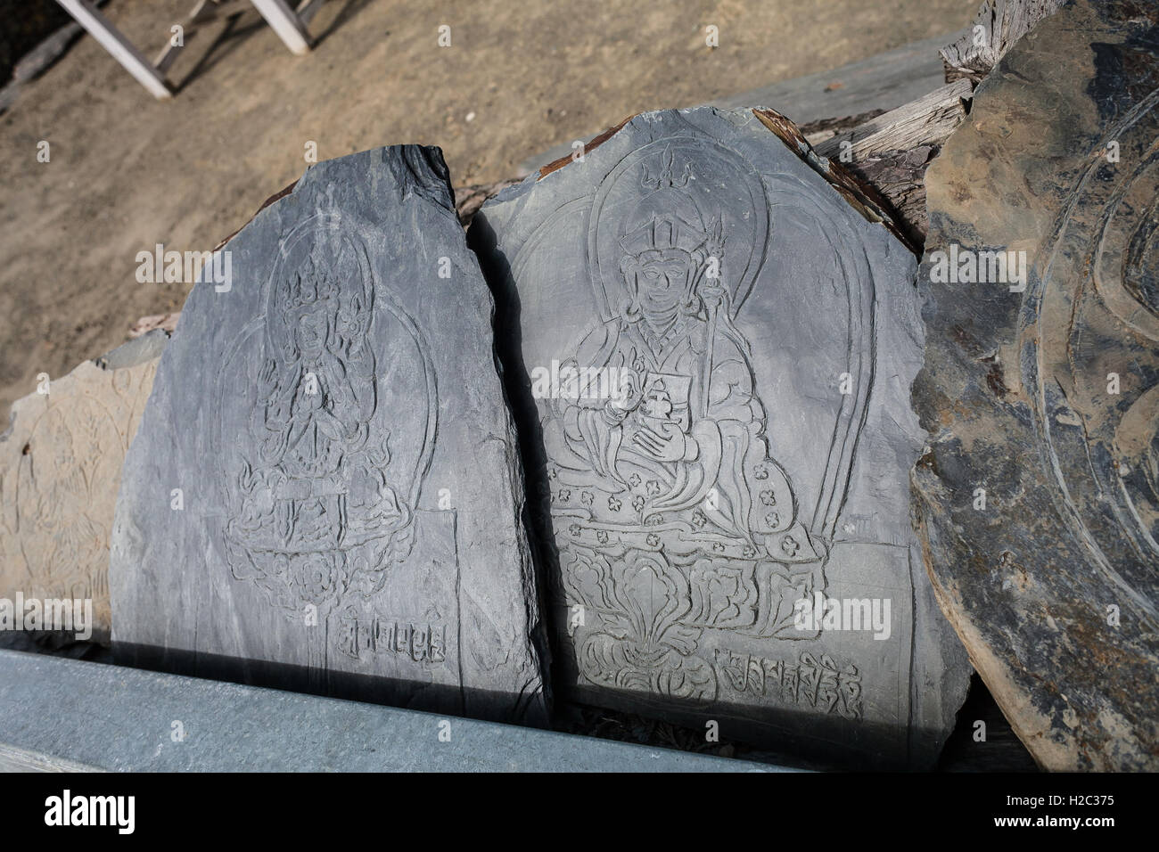 Closeup Photo Autentic Draw Stone Budda Symbols and Mantras. Horizontal. Nepal Travel Trakking Stock Photo