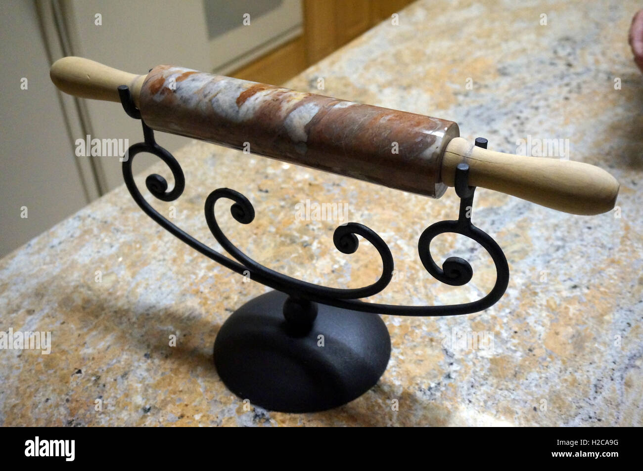 Decorative Marble Rolling Pin Displayed On A Wrought Iron