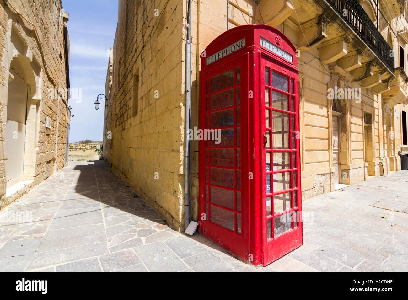 Red telephone box unusual location in Malta sunny weather - Stock Image
