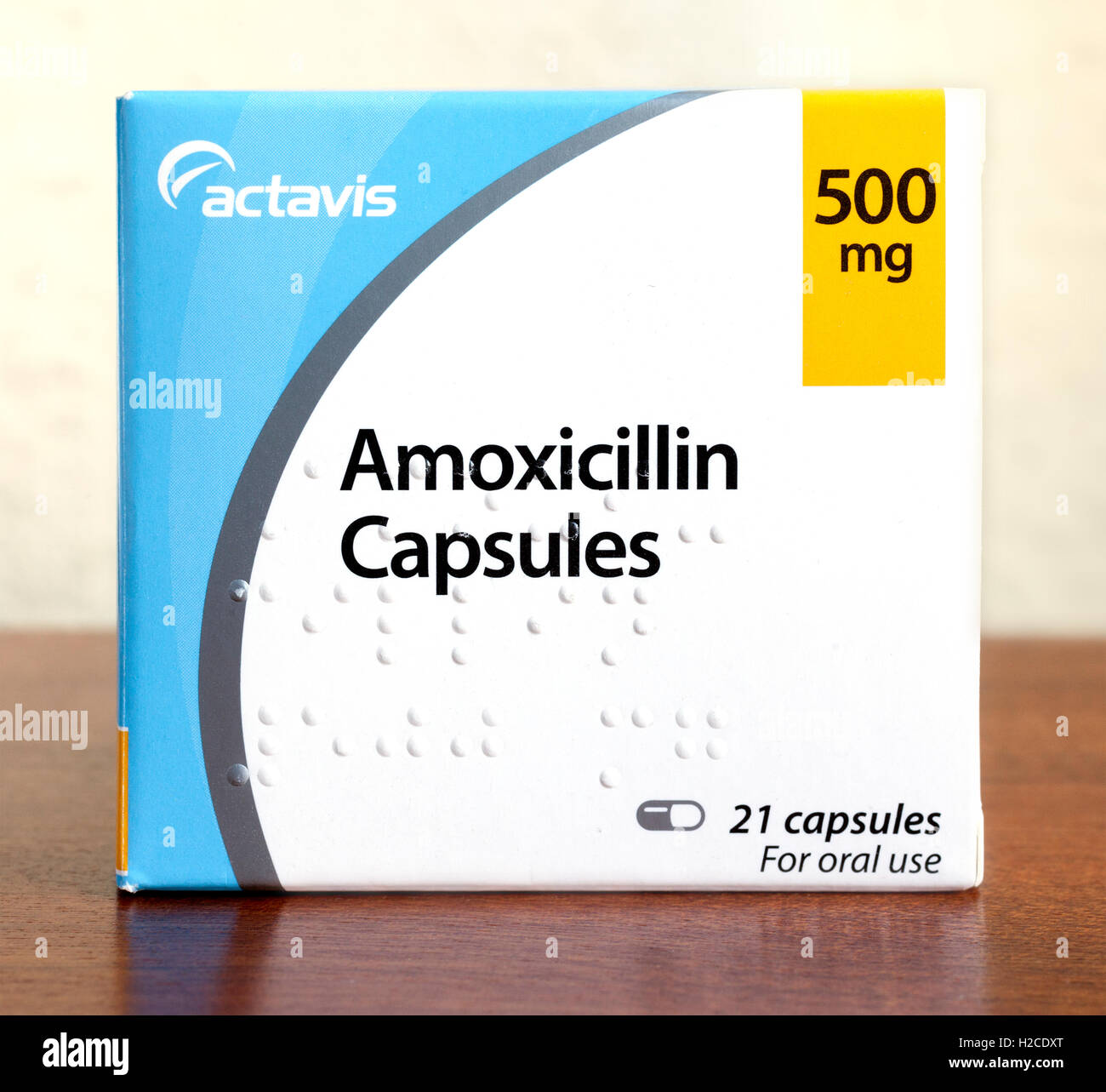 Box of Amoxicillin (penicillin antibiotic) capsules produced by Actavis. Braille is impressed on the front of the - Stock Image