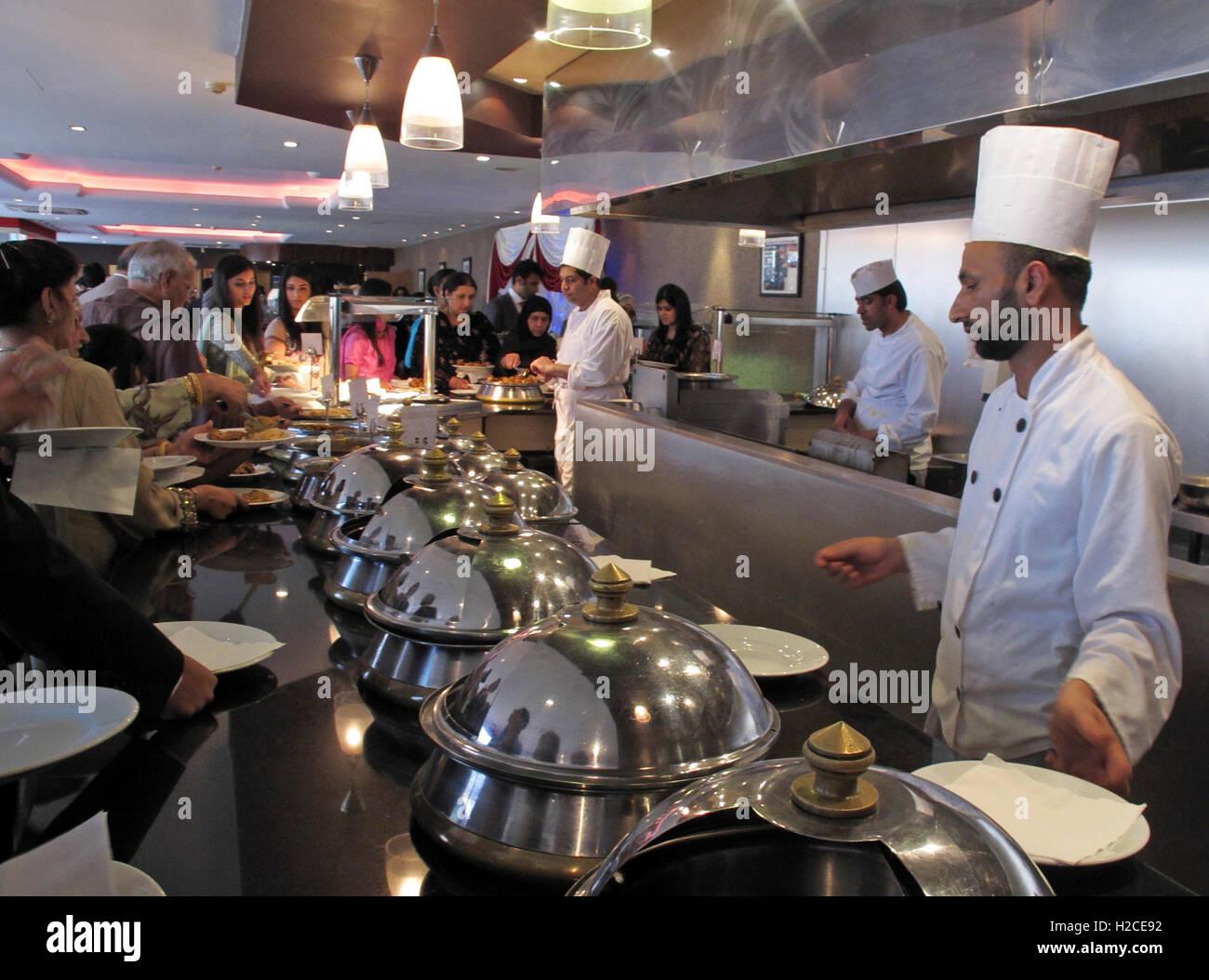 Indian buffet wedding lunch, chefs, various food dishes - Stock Image