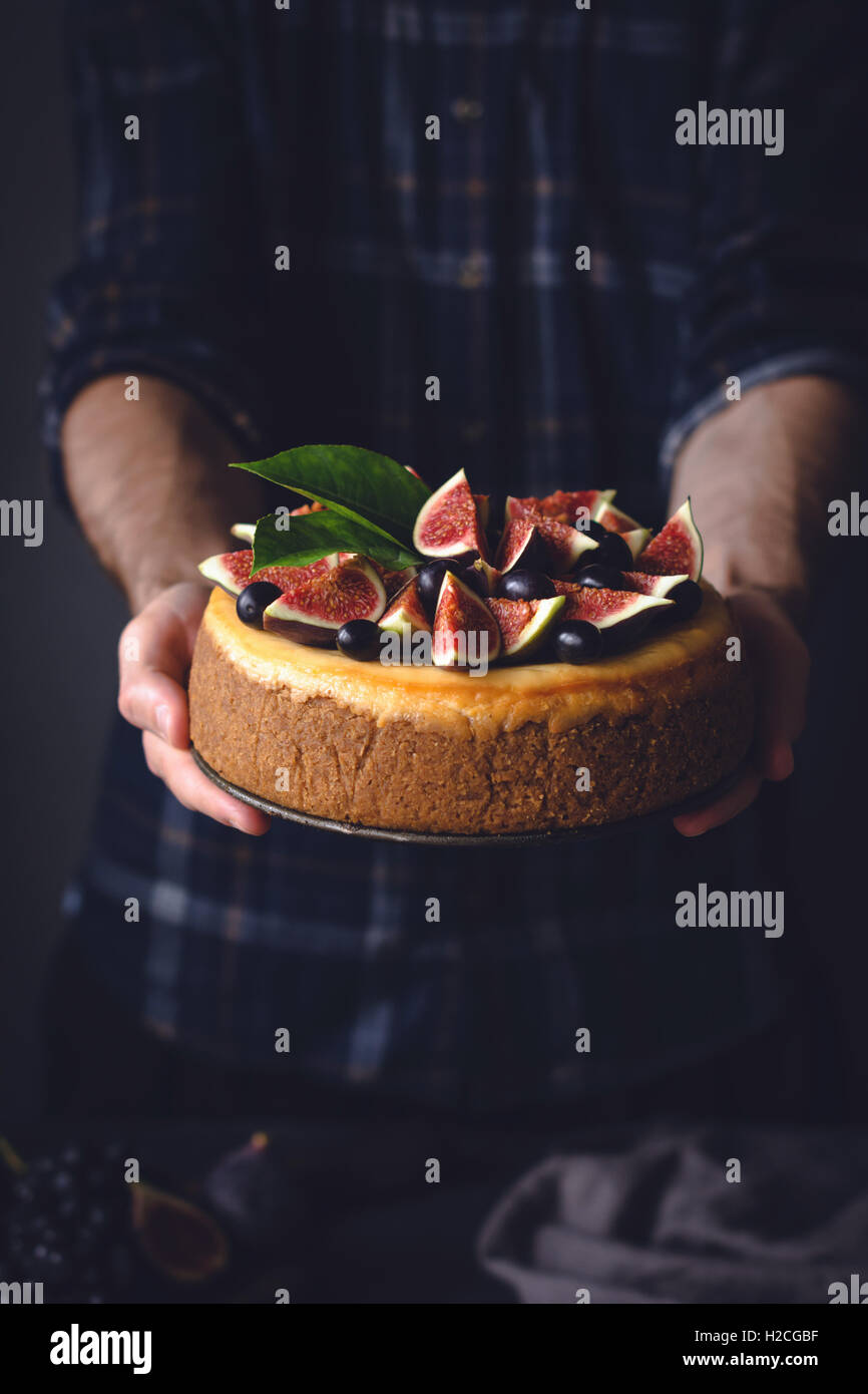 Male holding cake in hands. Comfort food at holiday celebration. Wedding, birthday concept - Stock Image