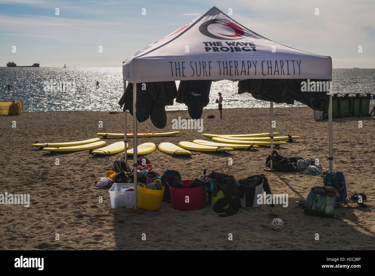 The Wave Project at Gyllyngvase Beach, Falmouth helping youngsters overcome issues through surfing. - Stock Image