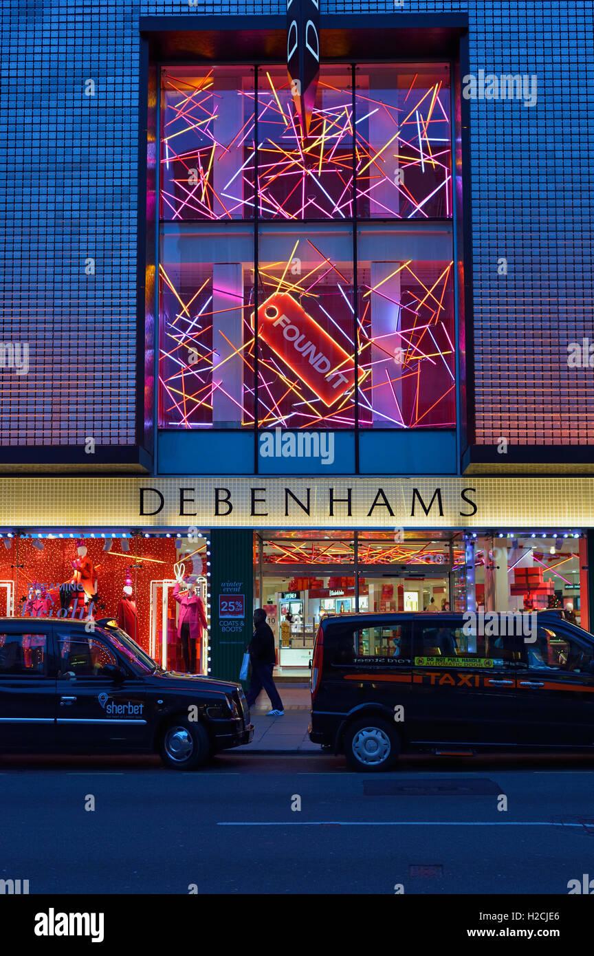 Taxis outside Debenhams department store, Oxford Street, London, United Kingdom - Stock Image