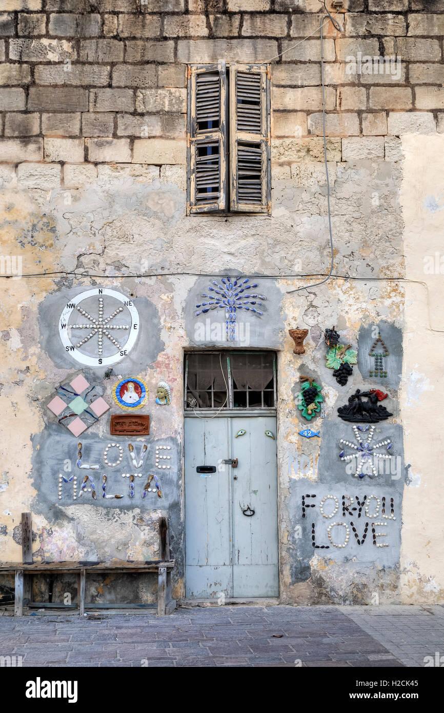 colourful wall decoration in Marsaxlokk, Malta - Stock Image