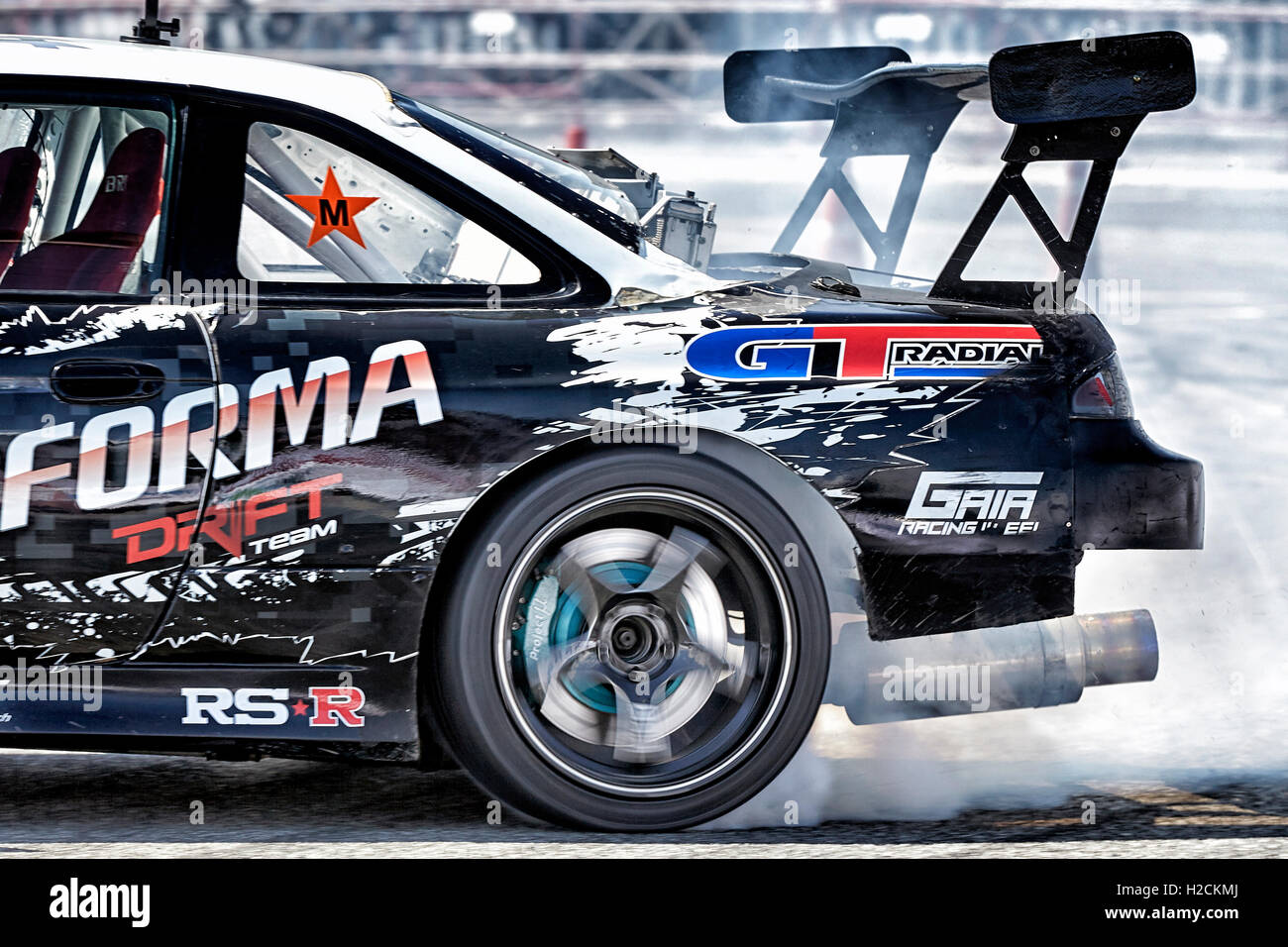 Car drifting auto racing event action with smoking tyres