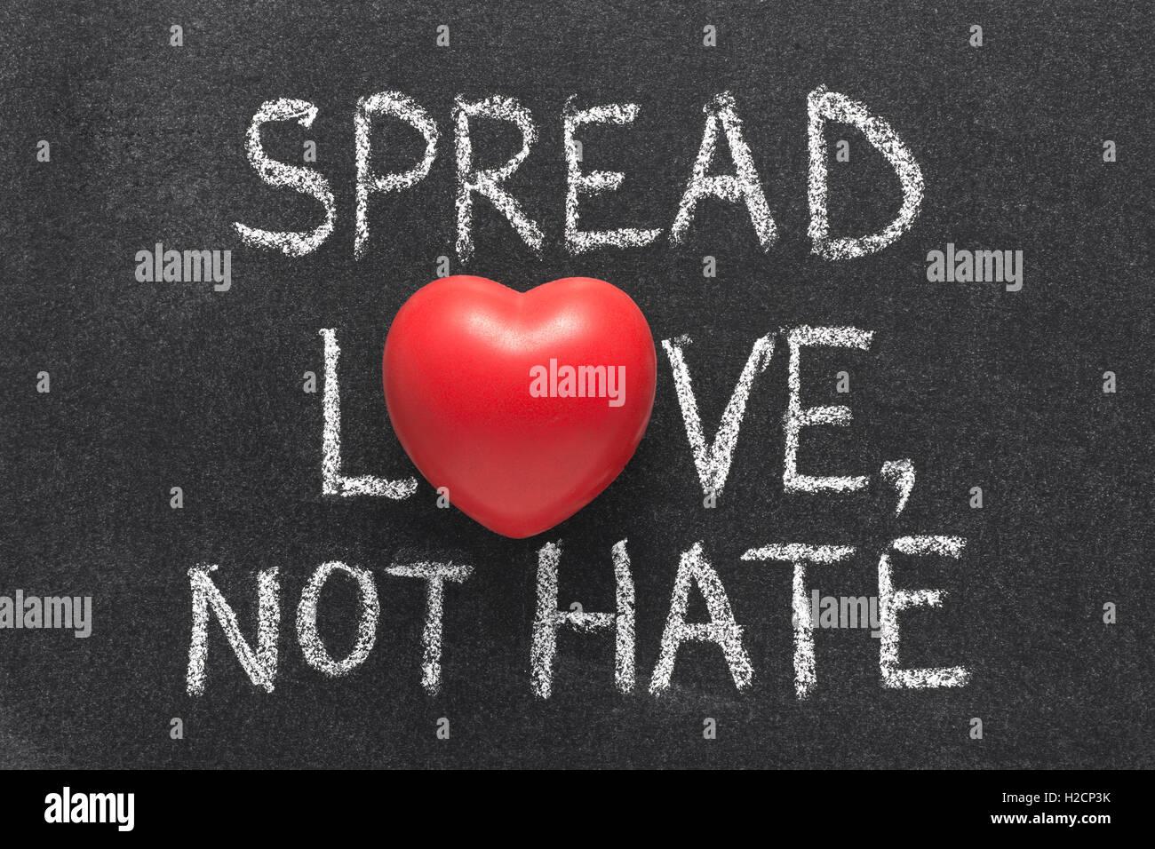 Spread Love Not Hate Phrase Handwritten On Blackboard With Heart