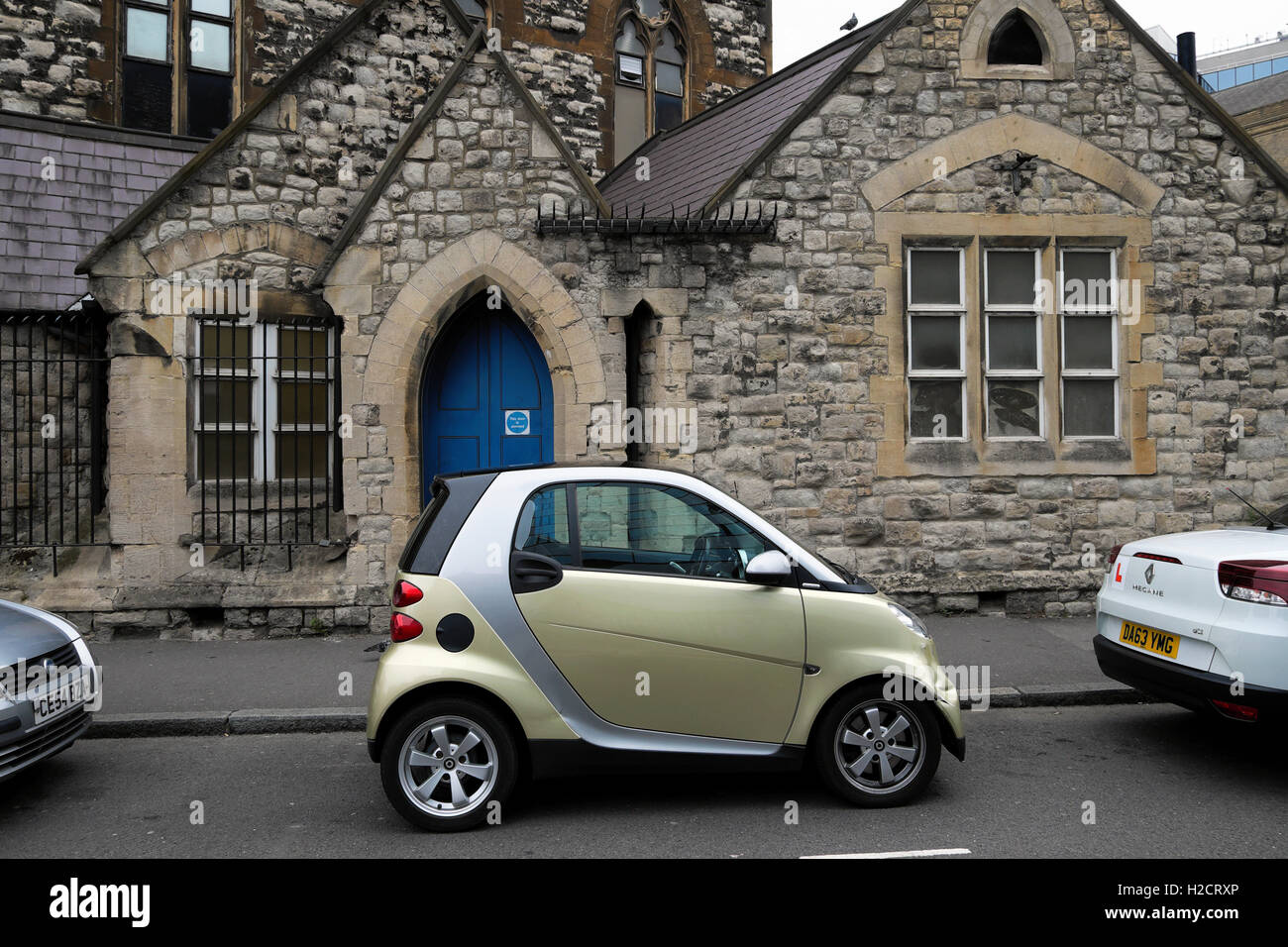 Smart car parked outside Whitefield's Tabernacle Moorfields in Tabernacle Street East London UK - Stock Image