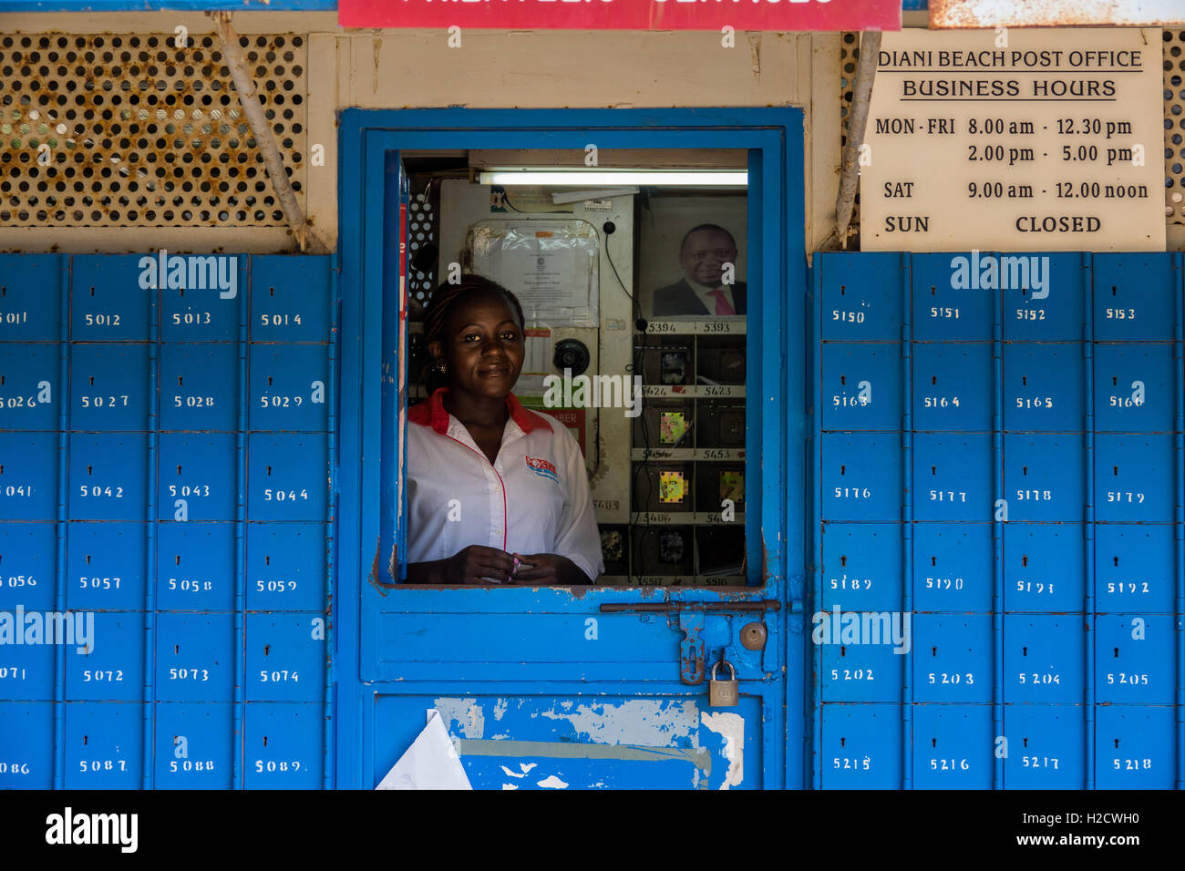 a postal worker tends a post office in Diani Beach, South Coast, Kenya - Stock Image