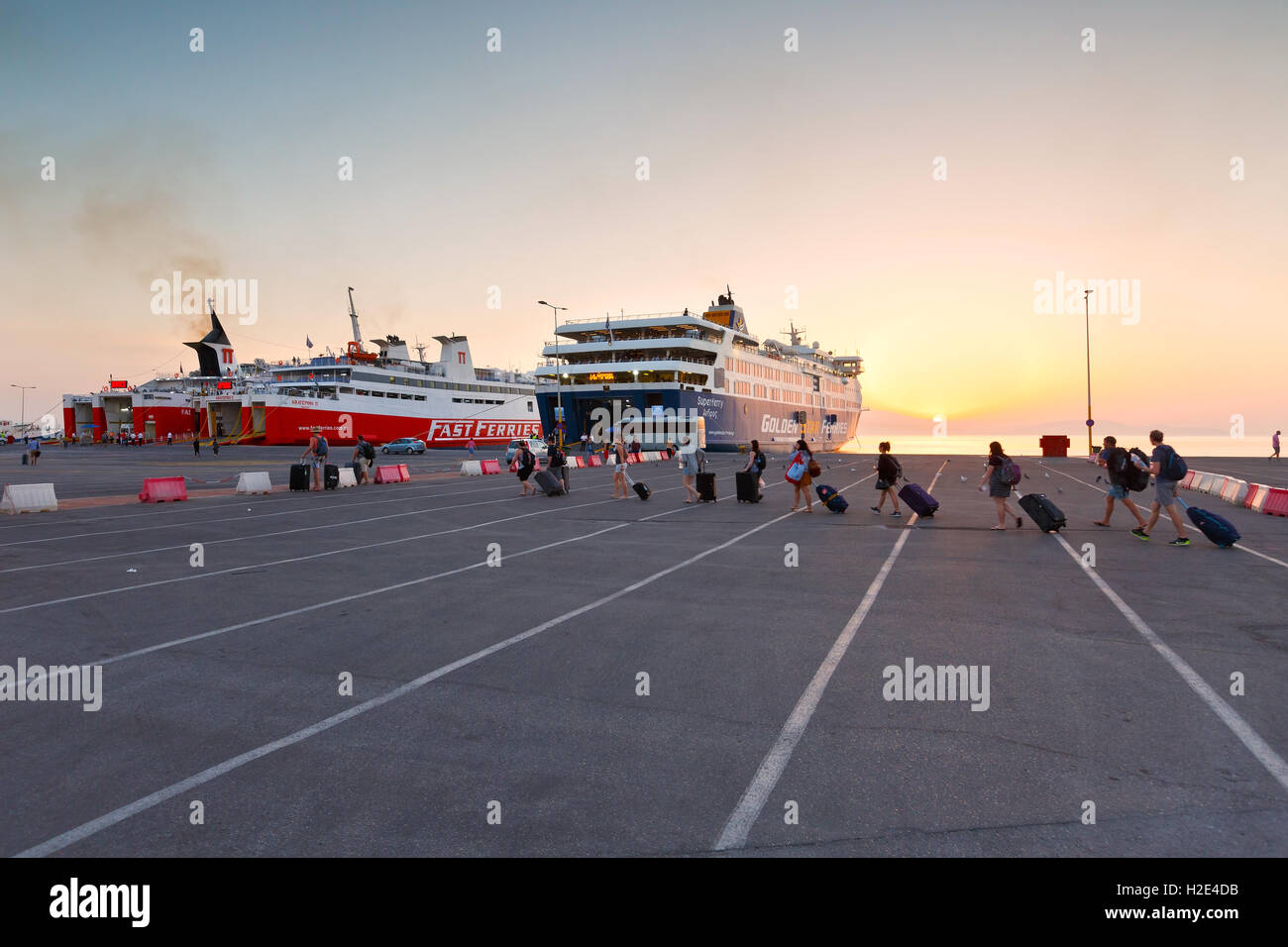 Tourists in passenger port of Rafina. - Stock Image