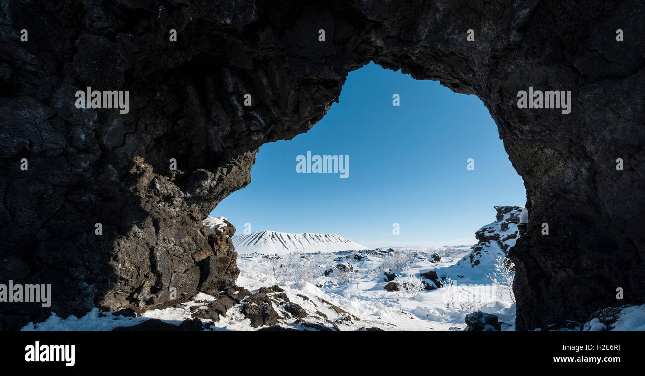 Natural arch, view of a snowy landscape, lava field covered with snow, Krafla volcanic system, Dimmuborgir National - Stock Image