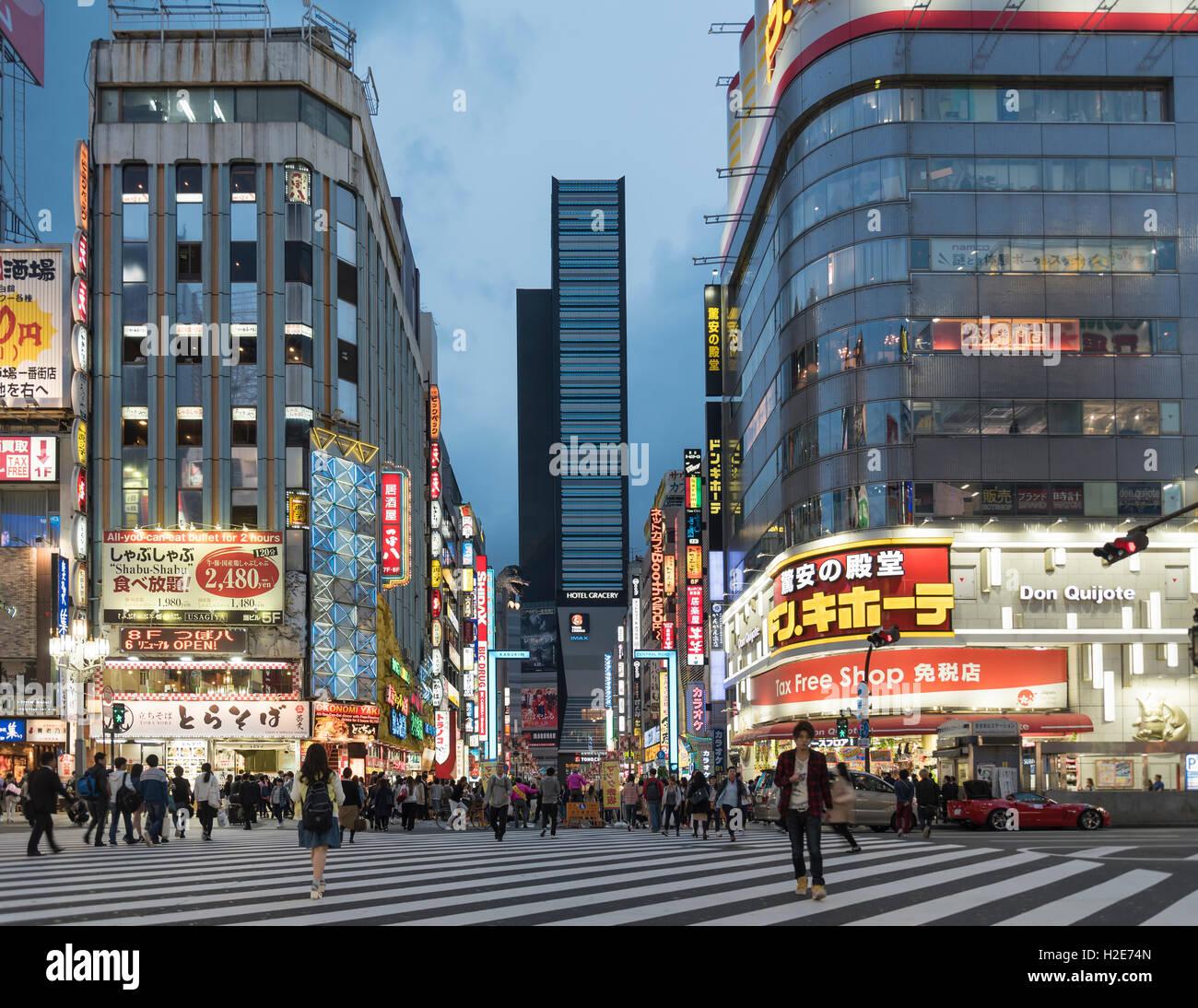 Kabukicho crossing at nightfall, Shinjuku, Tokyo, Japan Stock Photo