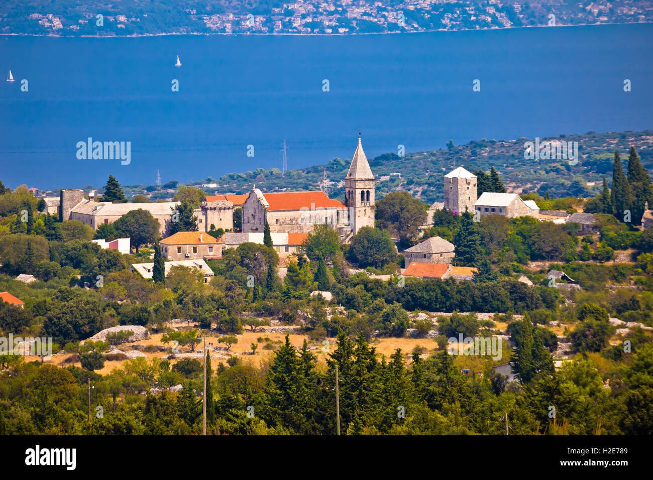 Village of Skrip stone architecture and Brac channel view, Dalmatia, Croatia - Stock Image