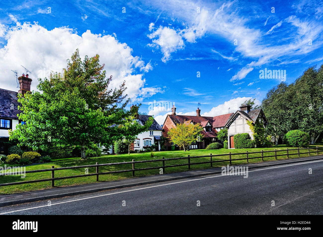 Old half timbered cottages punctuate the landscape of Eardisland, Herefordshire. - Stock Image