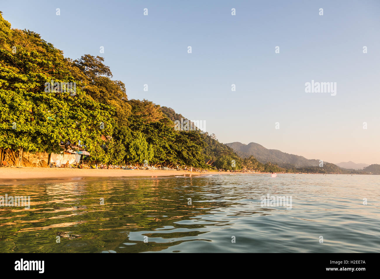 Sunset over white sand beach in Ko Chang, Thailand. This is  a popular island in the gulf of Thailand close to cambodia. - Stock Image