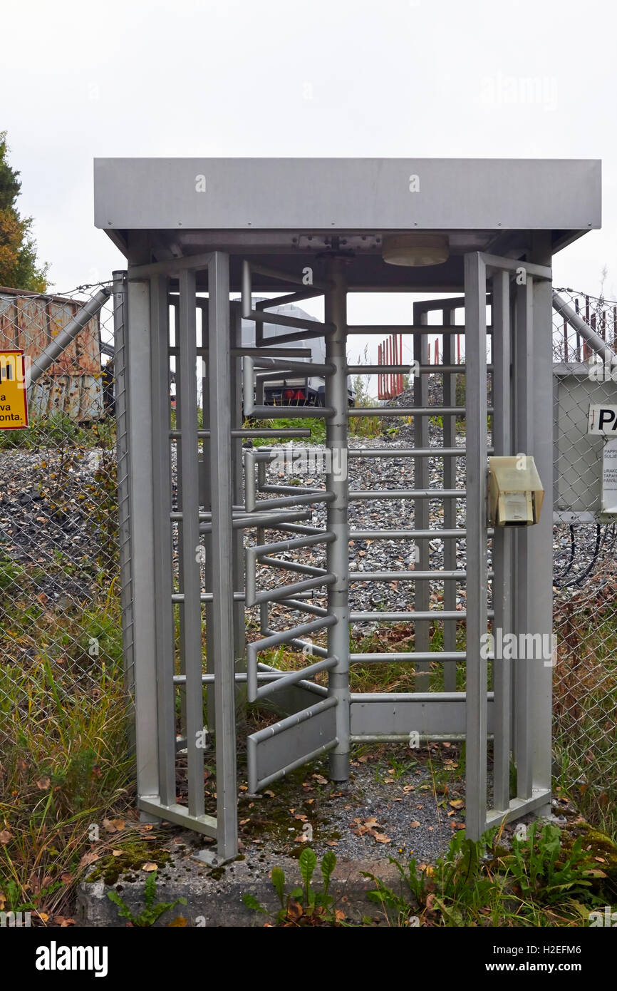 revolving metal gate at outdoor entrance Stock Photo
