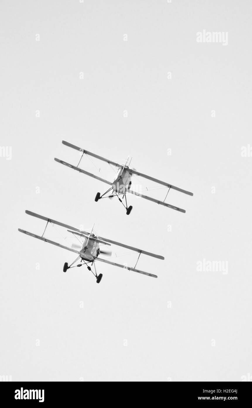bi-plane in flight during an air show Stock Photo