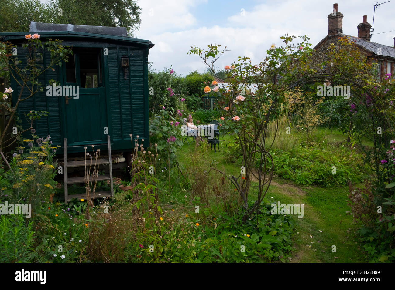 Original Showman's Wagon in cottage garden now used as a holiday let, Norfolk, England, UKk - Stock Image