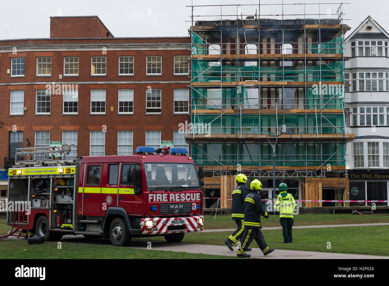Firefighters damp-down a blaze which gutted the Castle Art Gallery, Cathedral Yard, Exeter, UK. - Stock Image