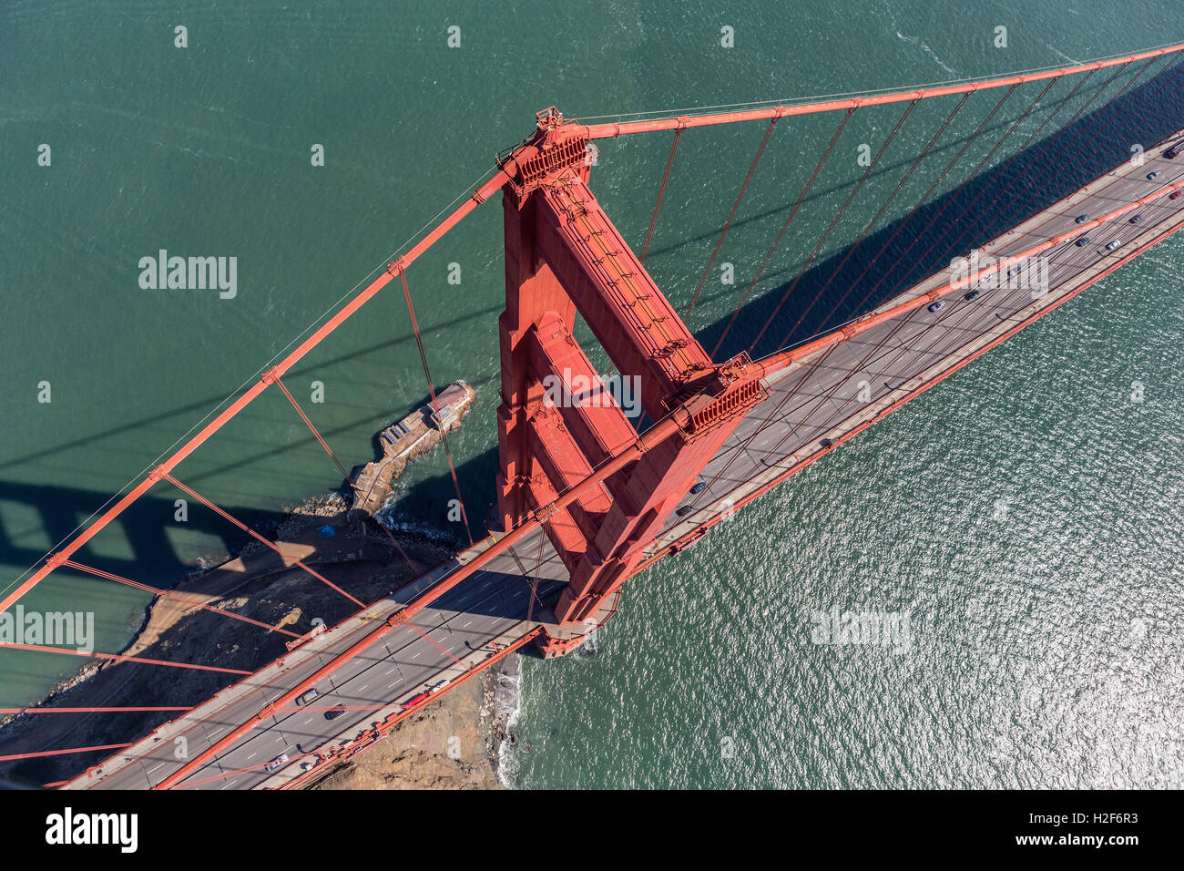 Aerial view of Golden Gate Bridge suspension tower, cable and road above San Francisco Bay in California. - Stock Image