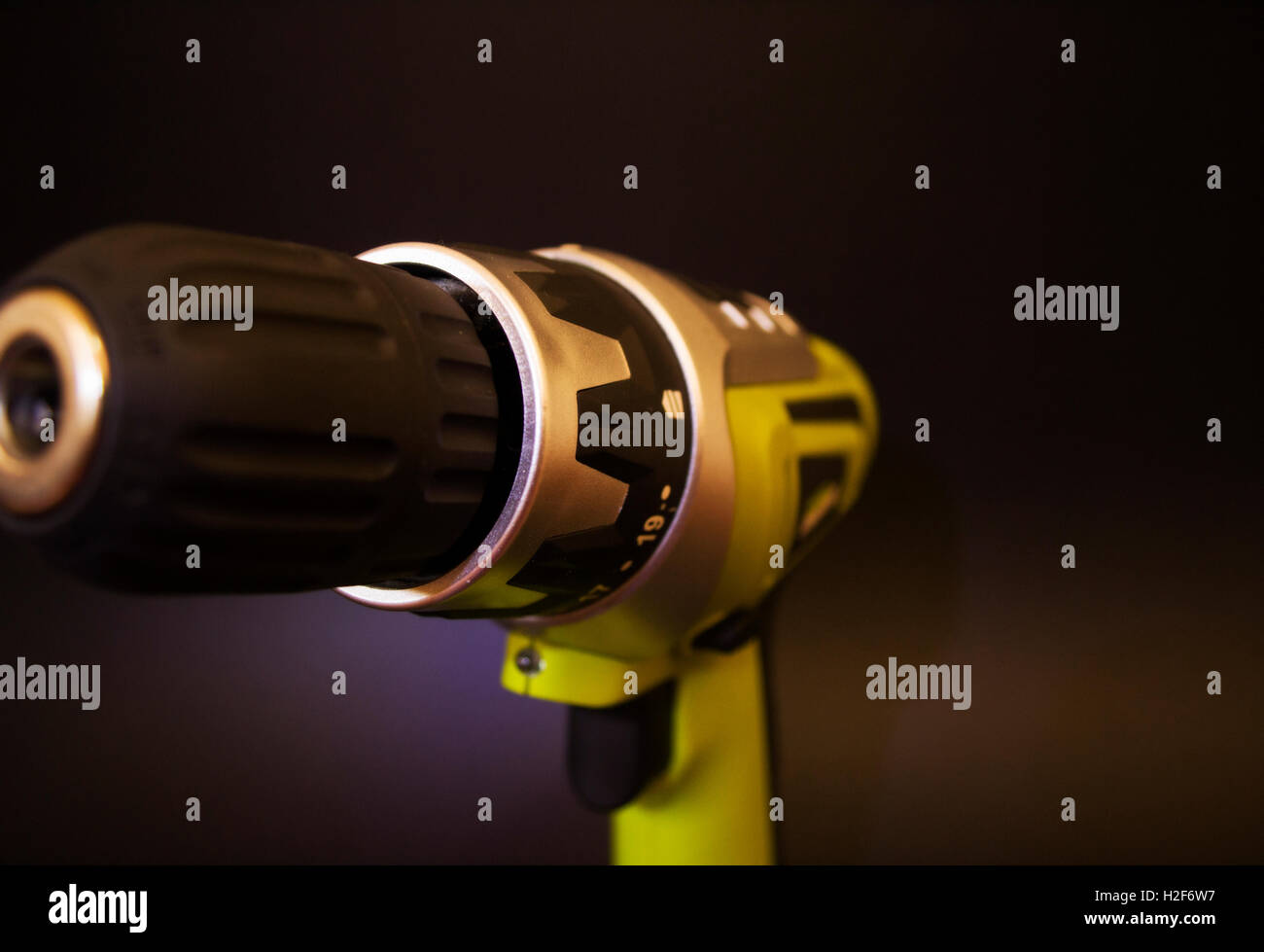 green drill tool image with white background. Battery operated power drill tool - Stock Image