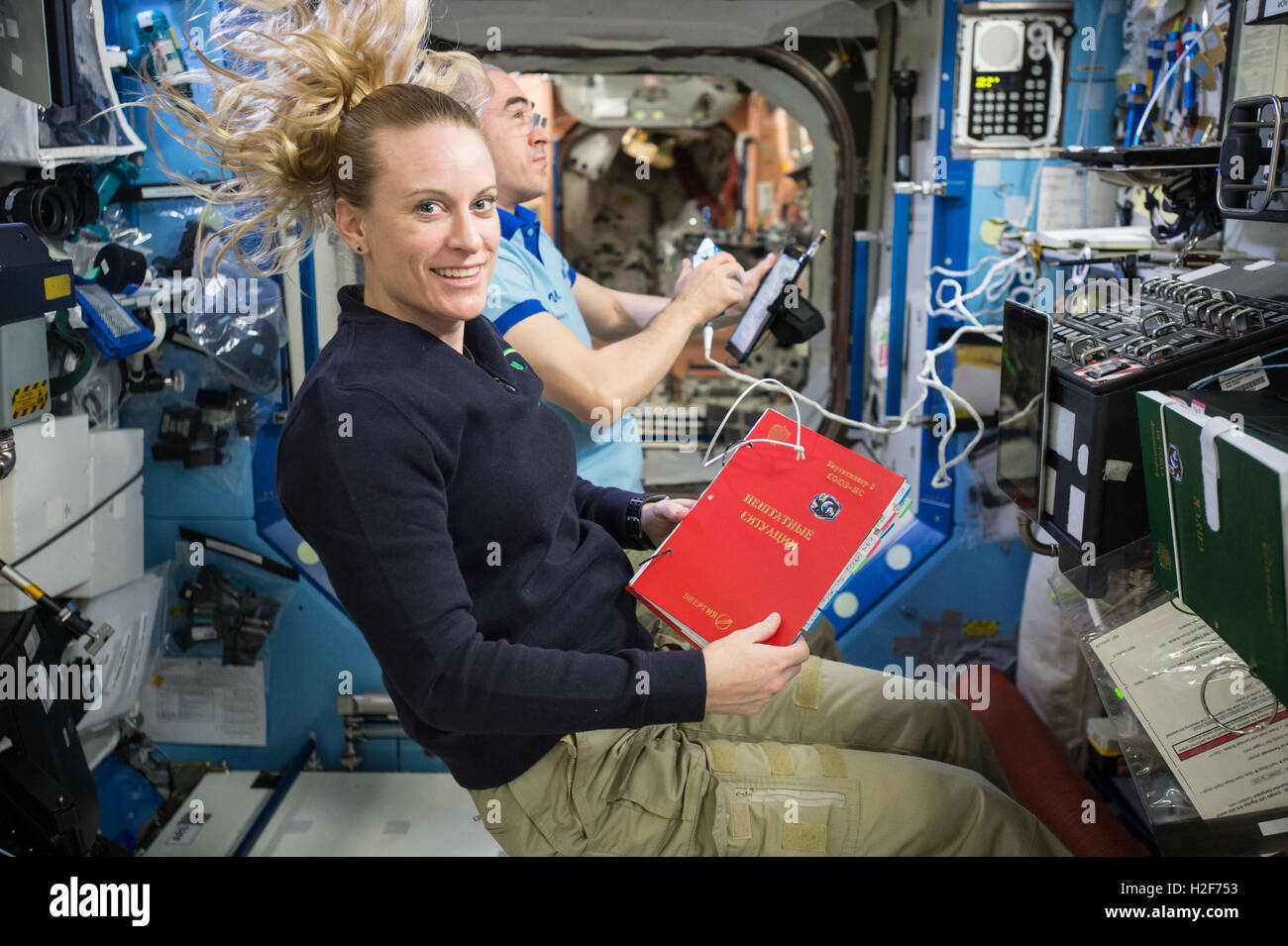 American astronaut Kate Rubins participates in an emergency descent drill September 9, 2016 aboard the NASA International - Stock Image