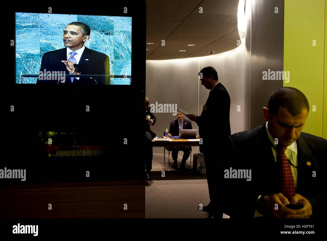 White House staff wait backstage as U.S. President Barack Obama delivers his address to the UN General Assembly - Stock Image