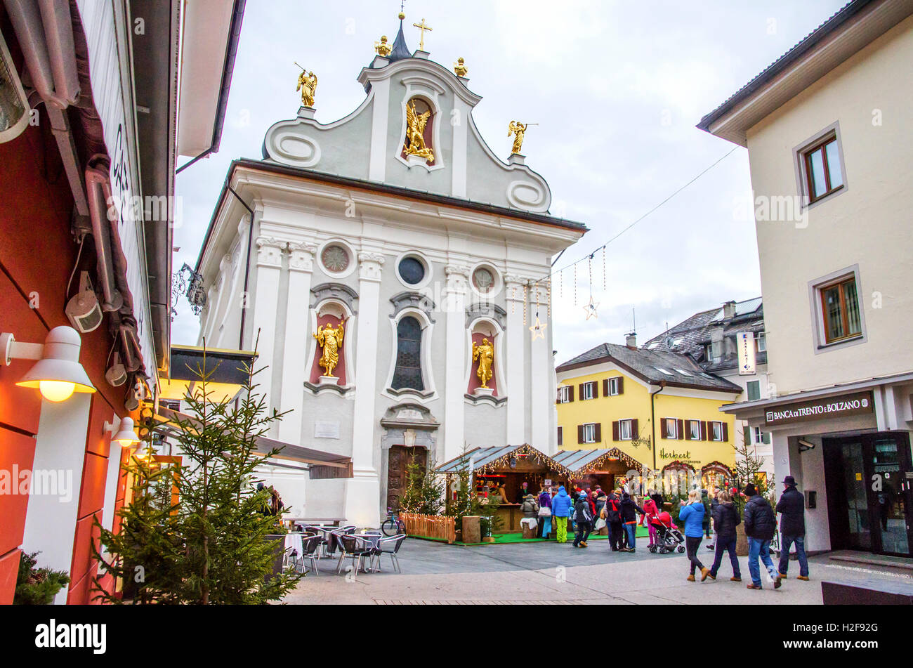 Brunico, Italy, 14 December 2014: christmas markets in the central square of San Candido with the main church's - Stock Image