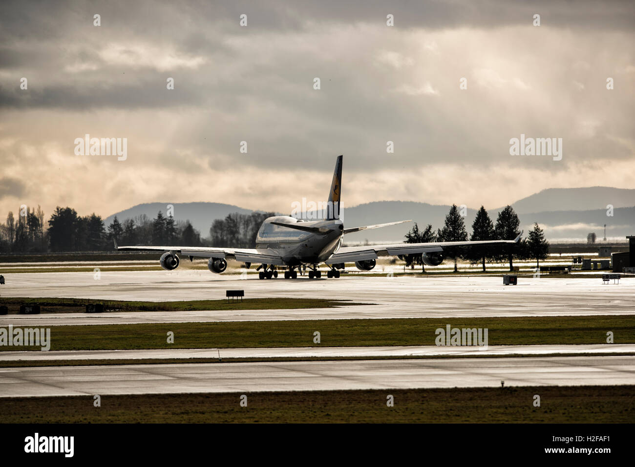 Lufthansa Boeing 747 taxiing down the tarmac, Vancouver International Airport, British Columbia. - Stock Image