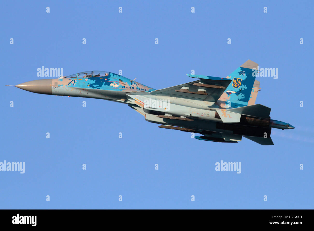 Military aviation. Sukhoi Su-27UB Flanker jet fighter airplane of the Ukraine Air Force flying in the sky - Stock Image