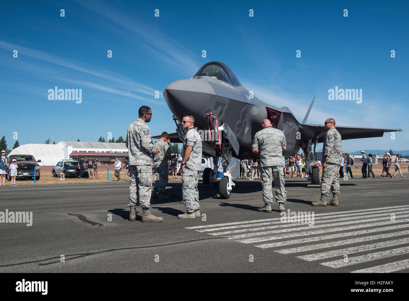 US Airmen guard the Stealth F-35A fighter jet, at the Abbotsford airshow, British Columbia. - Stock Image