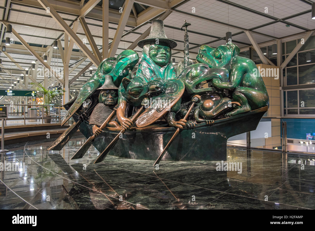 The Spirit of Haida Gwaii The Jade Canoe, Bill Reid's bronze sculpture displayed at the Vancouver International - Stock Image