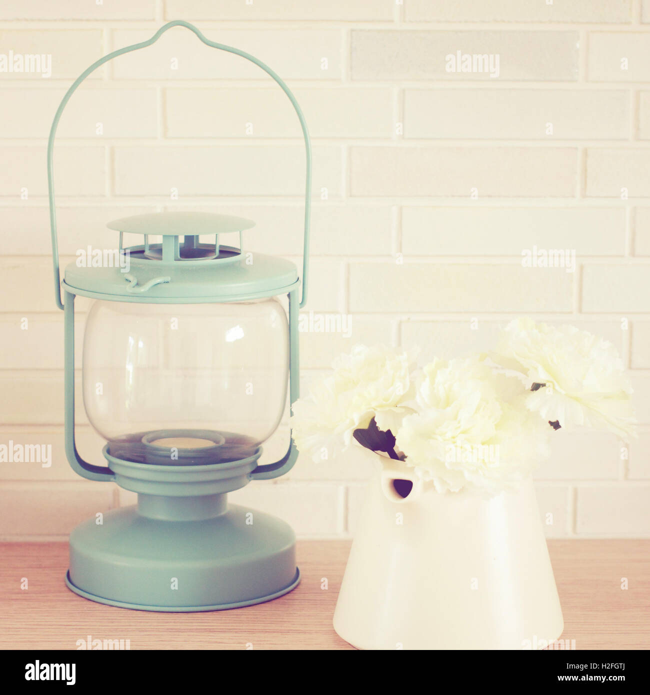 Vintage lamp and flower with retro filter effect - Stock Image