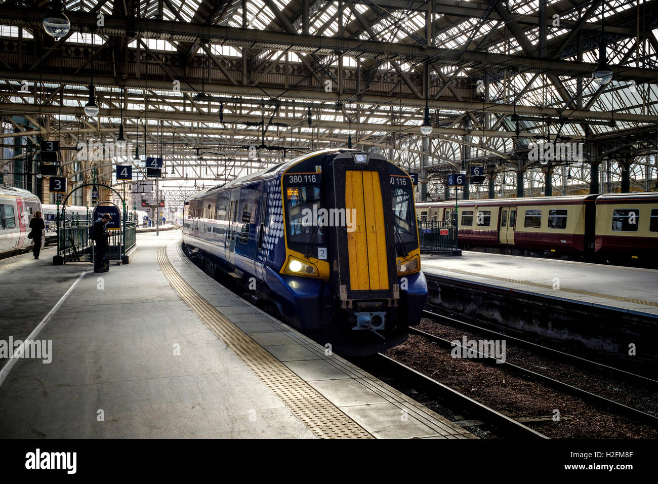 A local ScotRail commuter passenger train arriving at Central Station in Glasgow, Scotland - Stock Image