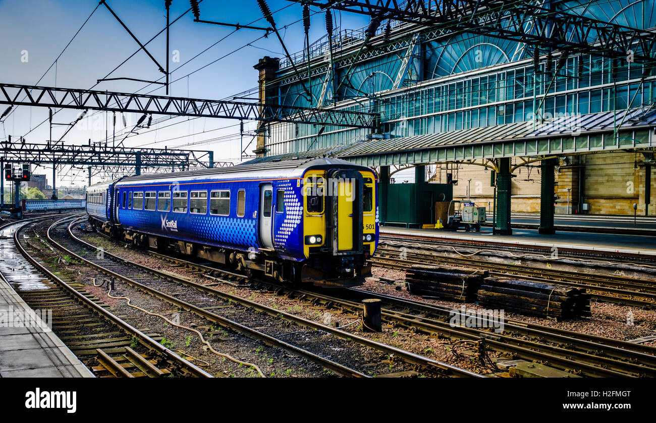 ScotRail passenger train departing from Central Station in Glasgow, Scotland - Stock Image