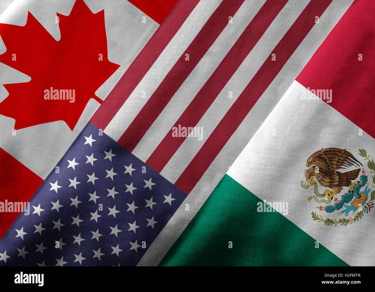 Close up of the flags of the North American Free Trade Agreement NAFTA members on textile texture. Stock Photo